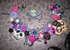 Punk Rock Charm Bracelet Rockabilly Gothic Girly Glam Emo Scene Statement Jewelry Piece Skull Stars Candy Bat Pink Purple Beads. $36.00, via Etsy.