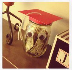 DIY graduation gift made out of a jar, card stock, yarn, googley eyes, & dollar bills. Will include theme park tickets inside. #graduationgifts #graduation #gift