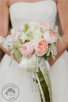 Garden rose wedding bouquet: juliet garden roses; white sweet pea; polar star roses; tuberose; pieris japonica