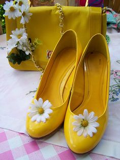I had some shoes just like this when I was a little girl! But I think the flower also had some black on it and of course not high healed