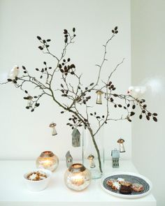 Using a branch in a vase for hanging jewelry or decoration