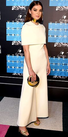 The Best and the Boldest Looks of the Night   HAILEE STEINFELD   One way to stand out among a sea of skin-showers? Completely cover up like Hailee does in a cream-colored jumpsuit and capelet. Her gleaming gold neck collar, clutch and pumps also bring some major shine.