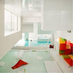 kids play pool, Les Bains Des Docks Aquatic Center in Le Havre, France. Designed by Ateliers Jean Nouvel.