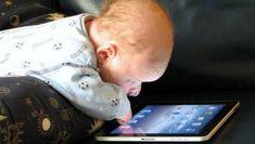 baby playing on iPad
