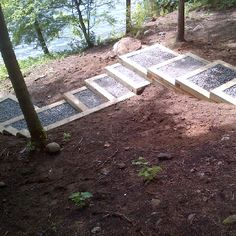 Another view of our hillside stairs heading to the lake. Built by RV Jones Landscaping of Kingston, Ontario, Canada.