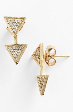These gold studs have a triangle detail in front and also drop from the back to create a trendy three-dimensional style that hugs your ear.