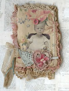 shabby vintage fabric and lace art journal with pink roses and lace heart