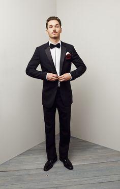 A handsome groom in modern black & white