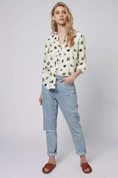 Tipped to be the print of the season, this Cactus print long sleeve shirt is an instant wardrobe update. Style with jeans to let this conversational piece do the talking. #Topshop