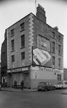 The Peacock Pub junction of Marlborough Street, and Waterford Street, Dublin Waterford Street has been eraced from the map.wonder if Grandad ever drank in here? Dublin Street, Dublin City, Old Pictures, Old Photos, Al Capone, Belfast, Historical Photos, Street Photography, Sean Mcdermott