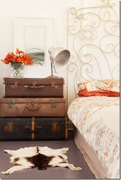 I love the slight sag in this suitcase bedside table. What would you keep inside? Maybe blankets for winter.