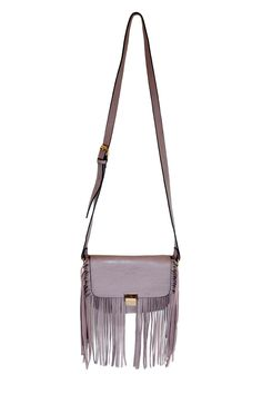 """Vegan leather structured mauve purse with fringe detail and fold over metal clasp closure. 3 pockets with one zippered on the exterior and one zippered inside. The Krista purse is a little bit country a little bit rock and roll... Looks great with a bohemian yet fitted outfit.  Measures 9"""" x 7.5"""" (or 13"""" including fringe) with an adjustable 48"""" strap  Krista Crossbody Mauve by Mellow World. Bags - Cross Body Vancouver Canada"""