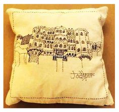 Beautify your Home with this kantha embroidery stitch small scented cushion, it gives new and exceptional look to your decor. A picture Jodhpur Palace is stitched on the cushion. Perfect gift that add lively colors to your decor. The base color is white.Handmade, Indian Luxury embroidered furnishings for Living Room, Dining Room, Bedrooms, Plagrooms and Study rooms or formal table linen in silk, cotton, jute, velvet or organdy  for Corporate Dining, all is now available at CraftsBazaar…