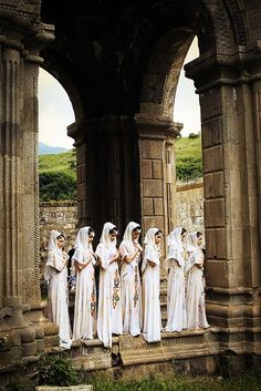 Armenian girls in traditional dress prepare for a religious ceremony at Tatev Monastery.
