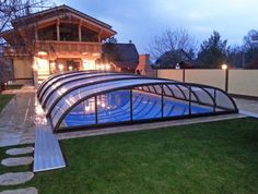 These creatively designed indoor swimming pools connect to nature and allow you to enjoy the outdoors no matter what the weather. Outdoor Pool, Outdoor Spaces, Outdoor Living, Retractable Pool Cover, Hot Tub Room, Automatic Pool Cover, Pool Enclosures, Modern Pools, Indoor Swimming Pools