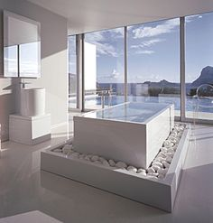 Soothing all white bathroom with a view