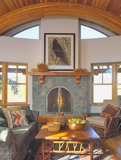 Barrel-Vault Ceiling  A series of arched, laminated beams supports this dramatic barrel-vault ceiling, which is warmed by slender planks of Douglas fir. Custom transoms echo the curve and let extra sunlight into the room.