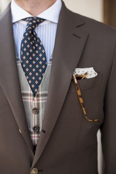 Windowpane check waistcoat by Michael Andrews Bespoke, Grey stripe contrast collar shirt by Ralph Lauren Black Label , Navy/orange geometric floral tie Vintage