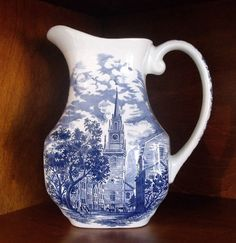 Liberty Blue Milk Pitcher Dinnerware Staffordshire Milk Pitcher, depicts the scene of the Old North Church located in Boston, Massachusetts.   Construction of this church was the location of the signal for the start of Paul Revere's famous ride to warn the colonists that the British were coming.   Some list this item as a water pitcher, but there is only one size of pitcher found in the Liberty Blue pattern. It makes just as much sense to use this pitcher for water.
