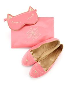 pink Charlotte Olympia cat travel set with eye mask, slippers and bag