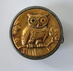 This is gorgeous: Antique Owl Tape Measure Cloth White Metal Brass Glass Eyes Germany Sewing | eBay