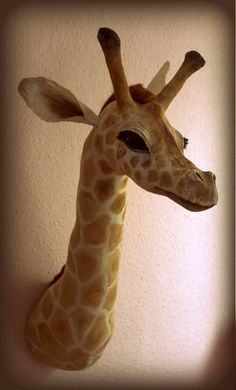 Faux-taxidermy fabric  wall-mounted giraffe. £299.00, via Etsy.