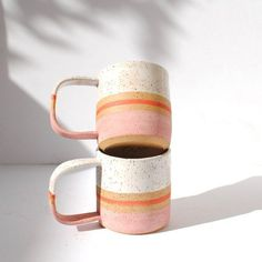 ***PRE ORDER (MADE TO ORDER)***  LIMITED QUANTITY OF BLUSH STRIPE MUGS WILL BE AVAILABLE MID/LATE APRIL. PRE ORDER YOUR MUG NOW!  STRIPE COLLECTION  **this listing is for ONE mug**  This rustic, handmade mug is perfect for your morning coffee or tea. The mug was wheel thrown and fired twice in an electric kiln. It is made of speckled clay. The inside is fully glazed while the outside is left partially raw which creates an organic, rustic look and texture. The glazes do not contain lead ...