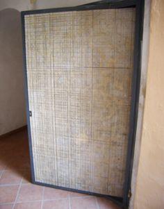 Porta blindata d'accesso realizzata con lato esterno in Travertino Romano fresato - /- realizzazione BlancoMarmo.it / Arredi realizzati da Oggetti.it / design by LauroGhedini.com