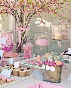 cherry blossoms as a centerpiece for pink communion dessert table