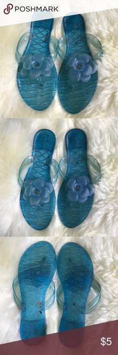 Clear blue jelly glitter thong sandals size 9 Used clear blue glitter jelly sandals.. has wear .. flowers are a little faded ... perfect for the beach and for spring! Shoes Sandals