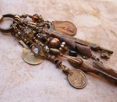 Mixed Media Vintage Charm Necklace with Antique Key, Vintage Crystal, and Buddhist Charm. $477.00, via Etsy.