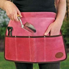 Pink Suede Tool Apron/Roll  Hard wearing and gorgeous - use to store and /or carry small hand tools    Suede and leather apron for practical gardening. If you've got the gloves why not go for the apron! Stunningly practical too.    Store small hand tools in it, such as secateurs, scissors, forks and trowels and it becomes a tool roll.    Waist fitting, four pocket work apron/tool roll. Handmade by local craftsmen in the UK, using traditional methods and only the finest materials.
