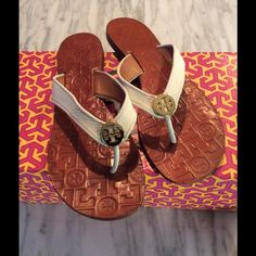 Tory Burch Thora Sandals TB Thora sandals in white leather and gold medallions.  These have been worn, however still look new.  Ships w/o box the same day of purchase confirmation. Tory Burch Shoes Sandals