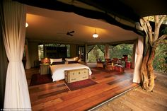 Wood you believe it: The Mara Plains camp is woven into the vegetation, with the trees used as supports for the tents
