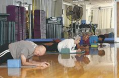 Participants in the yoga class at Tarawa Terrace Fitness Center on Marine Corps Base Camp Lejeune had the opportunity to channel their inner peace on the mats Monday. The lights were shut off in the room and everyone focused on building physical and mental strength.
