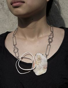 L. Sue Szabo, sgraffito enamel and sterling silver necklace.