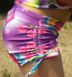 PDF pattern for reversible swim shorties with low and high-rise options and ruched sides.