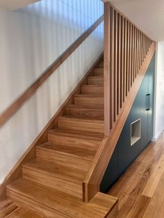 Blackbutt staircase with matching handrail and timber battens. Under stair storage cabinetry. Blackbutt staircase with matching handrail and timber battens. Under stair storage cabinetry. Stair Railing Design, Stair Handrail, Staircase Railings, Staircase Ideas, Staircase Makeover, Stair Bannister Ideas, Wooden Staircase Design, Handrail Ideas, Timber Handrail