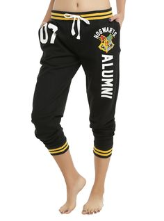 <p>Comfy girls pajama pants from <i>Harry Potter</i> with a Hogwarts Alumni themed design and an elastic drawstring waist. Golden yellow stripes on banded waist & leg openings.</p>  <ul> 	<li>100% cotton</li> 	<li>Wash cold; dry low</li> 	<li>Imported</li> 	<li>Listed in junior sizes</li> </ul>