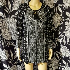 Aztec print tunic/dress Super cute black & white tribal print tunic or dress. Long sleeve, tassels at neckline. Like new, worn once. Bought at local boutique millibon Dresses Mini