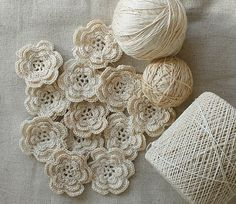 Crochet flowers. Pretty blog too. Maybe use flower pattern from Mollie Makes - like the plain white/beige colours