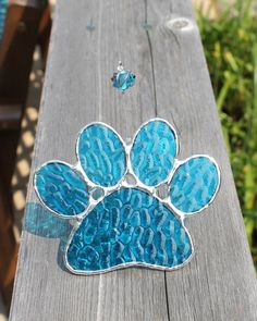Sky Blue Paw Print Stained Glass Suncatcher by GoodGriefGlass on Etsy https://www.etsy.com/listing/158890936/sky-blue-paw-print-stained-glass