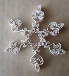 quilled snowflakes « HAUTE NATURE. No tutorial but love the designs...