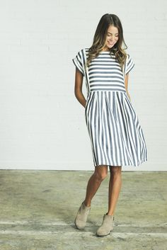 DETAILS: - Clad & Cloth Brand - Blue and ivory striped dress - Made from soft cotton linen blend - RUNS BIG (we recommend sizing down) - Knee length - Side zipper closure - Runs big, size down - Model