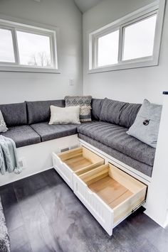 Beautiful storage in beneath the social area in Domino, a 24 ft. tiny house on wheels by Modern Tiny Living. Modern Tiny House, Tiny House Living, Living Room, Tiny House Trailer, Tiny House On Wheels, Small Loft Apartments, Home Financing, Tiny House Exterior, Save For House