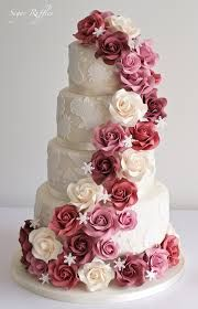 Stunning wedding cake with cascading roses in hues of marsala and pink #PPEvents