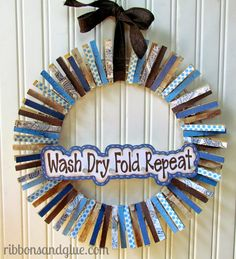 Clothespin Wreath  for the laundry room.  Modge Podge paper onto clothespins, clip on wire wreath.  {ribbonsandglue.com}