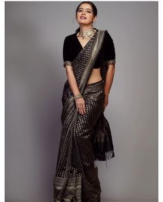 In a elegant black color saree with silver color border, elbow length sleeve blouse design and necklace Saree Blouse Neck Designs, Fancy Blouse Designs, Black Saree Blouse, White Saree, Trendy Sarees, Stylish Sarees, Sari Dress, The Dress, Indian Beauty Saree