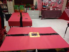 Super creative classroom decor for the a Polar Express or holiday party. Classroom tables covered in red butcher paper and and a belt made from Duct Tape. Love, love, love it!