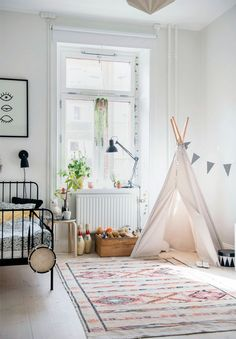 Delightful child's bedroom with teepee.